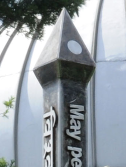 Stainless steel peace pole with raised text