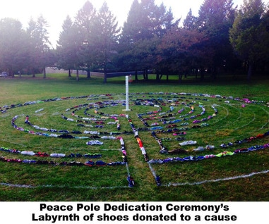 Shoes donated to a cause were used to make a labyrinth surrounding a peace pole for its dedication ceremony