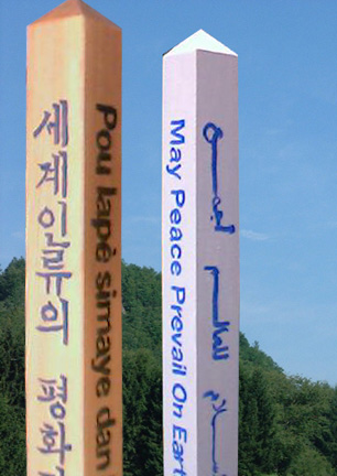 Hand painted text on peace poles
