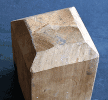 A flattened pyramid top cut into a peace pole
