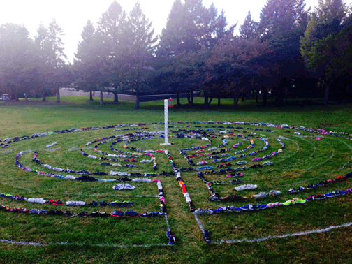 Labyrinth of shoes-donated-to-a-cause as temporary landscaping for a peace pole ceremony.