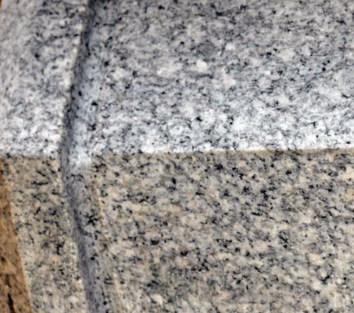Granite peace pole color up close