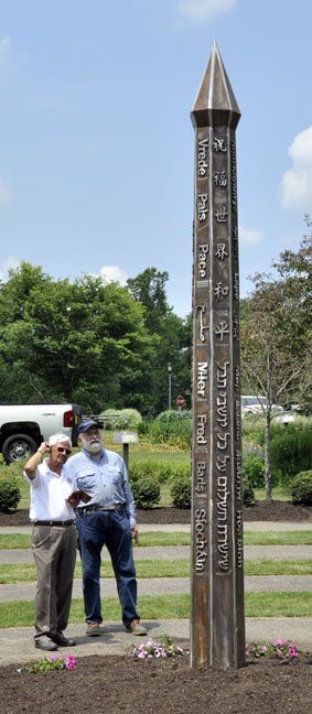 Large Stainless Peace Pole with people next to it for perspective